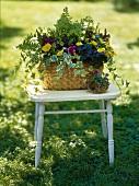 Flower arrangement in a basket out of doors