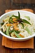 Stir-fried vegetables with Thai basil on rice