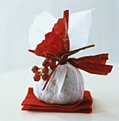 Gift-wrapped Christmas pudding (UK)