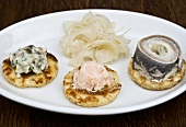 Blinis with smoked salmon, herring, horseradish and fennel