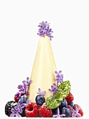 Panna cotta hat with fresh berries and lavender flowers