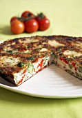Vegetable frittata, a piece removed