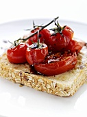 Cheese, tomatoes and balsamic vinegar on slice of toast