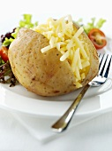 Baked potato with grated cheese and salad