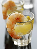 Two glasses of tequila with lemon, prawns on rim