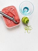 Raspberry & lime sorbet with ice cream scoop & sundae glass