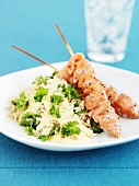 Grilled salmon kebabs with rice and parsley