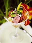 Salmon on sweet potato cream in a glass