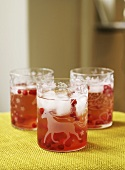 Three glasses of cranberry lemonade with ice cubes for kids