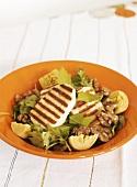 Grilled halloumi on artichoke and walnut salad