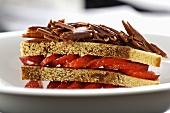 Hazelnut sponge layered with strawberries & chocolate curls