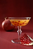 Champagne cocktail with pomegranate seeds