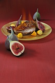 Flambéed duck breast with kumquats and figs