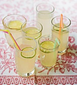 Six glasses of lemonade with straws