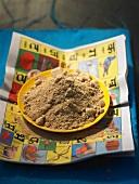 Mango powder (amchoor) on a plate