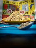 Mango powder (amchoor) on a plate with spoon
