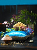 A small bowl of fenugreek seeds on a cushion