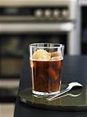 A glass of iced coffee with coffee ice cream & coffee ice cubes