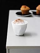 Caffè macchiato with nut muffins