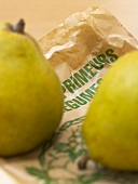 Two Williams pears on a paper bag