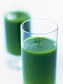 Parsley soup in two glasses