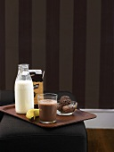 Cocoa, milk, banana and chocolate ice cream on tray