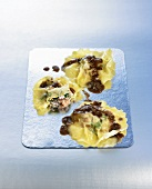 Three tuna ravioli with shallot sauce