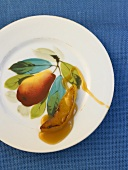 Caramelised slice of Williams pear on a plate