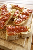 Pureed tomatoes and olive oil on slices of white bread