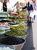 A selection of pickled olives on a market stall