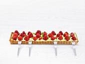 Rectangular strawberry tart with basil cream