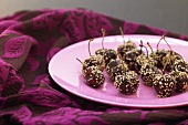 Chocolate-coated cherries with sesame seeds