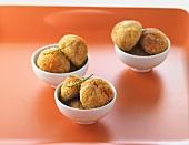 Fried tuna balls in three small bowls