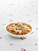 Wheat gratin with vegetables, garlic and cheese