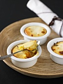 Individual peach puddings in baking dishes
