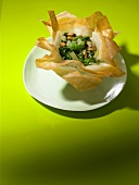 Spinach with walnuts in a brik pastry basket