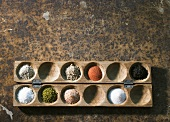 Various types of salt in a wooden game