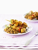 Pork and pepper kebabs with aubergines and orange