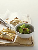 Pear tart with Roquefort and broccoli and bacon salad
