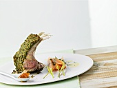 Rack of lamb in herb crust with sweet & sour apricots, carrots