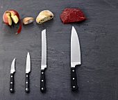 Various foods with the appropriate knives