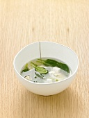 Clear broth with spinach and tofu