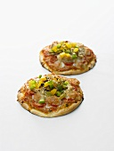 Two small vegetable pizzas