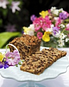 Fruit loaf on a cake stand decorated with flowers