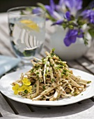 Kohlrabi and pea sprout salad with sesame dressing