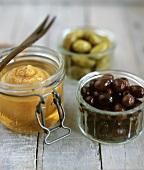 Pickled lemon and olives in preserving jars
