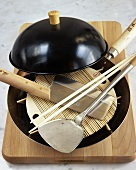 Asian cooking utensils on a wooden board