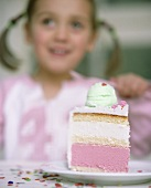 Girl with a piece of birthday cake