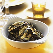 Grilled aubergine slices with herbs and garlic
