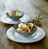 Yoghurt ice cream with caramel sauce and croutons
